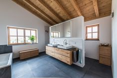 In this bathroom, the furniture was made from an elm wood and the doors matched to the windows from a knotless larch. This in turn harmonises perfectly with the elm, which has a particularly nice warm wood grain. A laundry chute is…Read Laundry Chute, Laundry In Bathroom, Modern Bathroom, Small Bathroom, Bathroom Cost, Bathroom Photos, Bathroom Bath, Bathroom Vanities, Bathroom Ideas