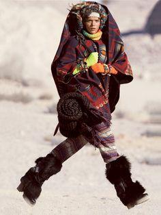 Spirited away :  Brittany wears a Lindsey Thornburg cloak. Iris von Arnim sweater. Kersh pants . Jennifer Behr kerchief,  . Aminaka Wilmont woven scarf (worn on head). Autumn Cashmere fingerless gloves . Domingo Ayala Collection bracelets  each. Rag & Bone blanket. D boots. Fall 2012