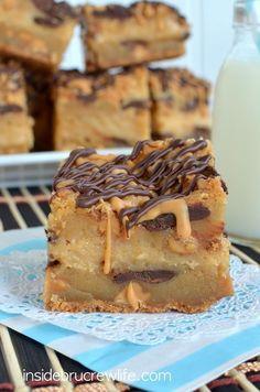 Peanut Butter Cheesecake Cookie Bars - peanut butter cheesecake in the middle of peanut butter and chocolate chunk cookie bars