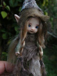 Lovely little sculpted fairy, by throughthemagicdoor, Etsy.