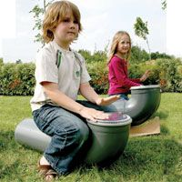TALK ABOUT SENSORY PLAY!  Big sewer pipes made into drums