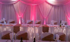 Gorgeous uplighting with head table backdrop Uplighting Wedding, Wedding Reception Backdrop, Wedding Tables, Wedding Day, Head Table Backdrop, Fabric Backdrop, Wedding Color Schemes, Wedding Colors, Led Light Fixtures