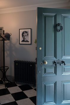 Farrow & Ball, front door in Studio Green, combined with walls in Cornforth White, radiator in Off-Black and woodwork in Worsted