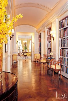 Sit Tight - Luxe Blog... We love the idea of displaying your library down a hallway. It's so bright and inviting!