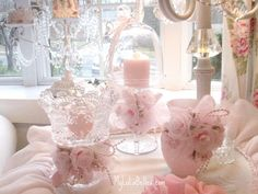 PINK Shabby Chic Decorating  Crystals, voile flowers, candles, ruffles.