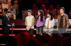 Host Ryan Seacrest and contestants Sam Woolf, Jessica Meuse, Jena Irene and Alex Preston onstage at FOX's 'American Idol XIII' Top 11 To 10 Live Elimination Show on March 13, 2014 in Hollywood, California.