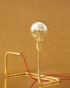 delicate table lamp gold tubing exposed bulb