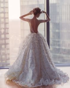 This bridal gown takes our breathe away with its beautiful flower details and gorgeous open back KATE'S BRIDE 2015   Kate's