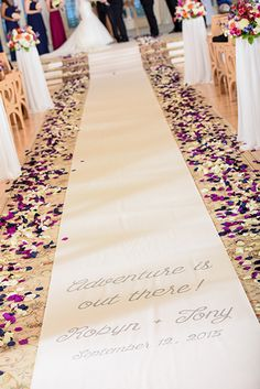 """Adventure is out there! We love this Disney Pixar's """"UP"""" inspired ceremony aisle runner at Disney's Wedding Pavilion"""