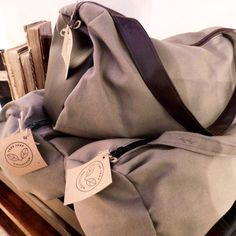 **This duffle bag is perfect for a day bag, gym bag, carry on bag or beach bag!** **It has a durable strap and zipper.** **Colour is an army green with black zipper. Duffle Bags, Tote Bag, Day Bag, Carry On Bag, Handmade Bags, Stay Tuned, Army Green, Etsy, Collection