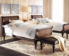 elegant British Colonial beds, with their woven cane insets and graceful turned legs,