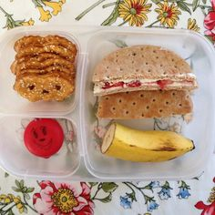 Strawberry cream cheese sandwich on whole wheat flatbread And BabyBella cheese, pretzel crisps, half banana.