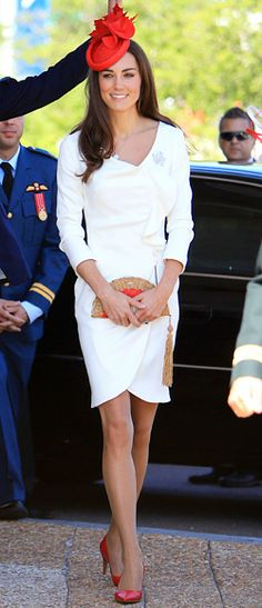 ivory Reiss dress that she wore in her official engagement photos. Middleton accessorized with a maple-leaf-topped fascinator by Lock & Co's Sylvia Fletcher, a fan-shaped Anya Hindmarch clutch and red pumps.