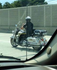 Motorcycle Cop Caught Texting