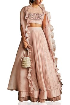 Featuring a pale pink ruched lehenga skirt in pure chiffon, silk chanderi and net base. It is paired with a matching dori blouse in crepe base having hand embroidery and a ruffled cape in organza base. Indian Fashion Designers, Indian Designer Outfits, Designer Dresses, Lehenga Skirt, Lehnga Dress, Cape Lehenga, Lehenga Style, Anarkali, Indian Attire