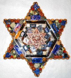 """The small (13"""" in diameter) star of David has a relief of Jerusalem in the center."""