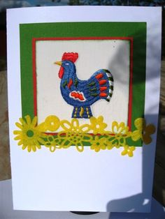 Birthday card to a person who´s a collector of Roosters. The rooster is sewn on mashine, Husqvarna Rose and a felt boarder under. Card made by Anna Jaawre.
