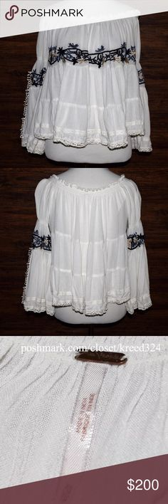 FREE PEOPLE Classic Top Patterned Bohemian Blouse Size XS. New Without Tags. $168 Retail + Tax.   • Classic & sophisticated, this banded off-the-shoulder blouse features intricate raw floral embroidered detailing & long flared sleeves.  • Loose, billowy, pleated accents. • Banded shoulders & sleeves. • Unlined. • Measurements provided in comment(s) section below.   {Southern Girl Fashion - Closet Policy}   ✔️ Same-Business-Day Shipping (10am CT). ✔️ Reasonable best offer considered when…
