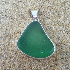 Green is the color associated with creativity, cultivation and fruition. Handmade sterling silver pendant set with vibrant green sea glass. The length of the pendant is about 1.75 inches. Looks beauti