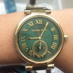 Michael Kors Emerald & Green watch New in box, all links included. Fixed gold-tone bezel set w baguette crystals. Emerald green dial w gold tone hands and Roman numerals. Minute markers around outer rim. Pull/push crown. Case diameter: 41.5 mm. Round shape. Band width: 20 mm. Band length: 7.45 in. Deployment clasp. Will take offers:) Michael Kors Accessories Watches