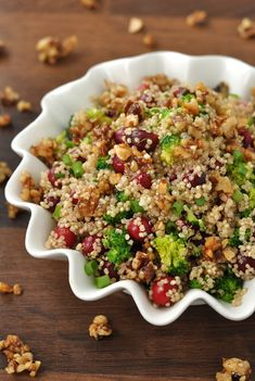 Cranberry Quinoa Salad: This fluffy quinoa salad is spiked with juicy cranberries, vibrant veggies and topped with homemade honey and brown sugar walnuts!