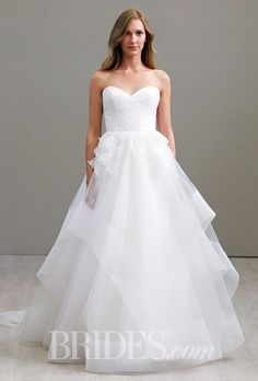 Love the tiered tulle skirt on this @jimhjelm wedding dress | Brides.com