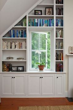 deep bookshelves & cabinets to surround our N office window (w/shelf over window connecting side bookcases) Bookcase Wall, Bookshelves Built In, Built Ins, Bookshelf Design, Slanted Walls, Slanted Ceiling, Attic Renovation, Attic Remodel, Ceiling Shelves