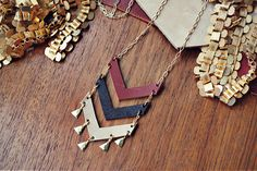 This handmade necklace features leather chevrons in all the best autumnal colors. www.mooreaseal.com