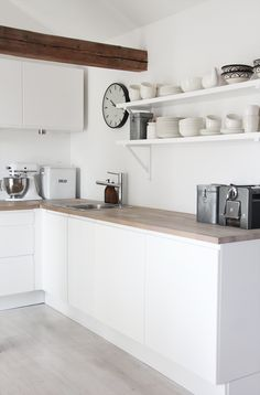 Photo by elisabeth heathland. White/butcher block counter.