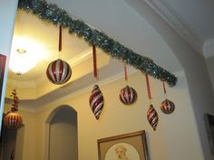 Ornaments on a tension rod: I like this idea.