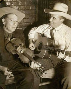 """Bob Wills with his father, champion fiddle player """"Papa John"""" 1940."""