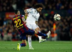 Marcelo of Real Madrid CF competes for the ball against Dani Alves of FC Barcelona during the La Liga match between FC Barcelona and Real Madrid CF at Camp Nou on March 22, 2015 in Barcelona, Spain.