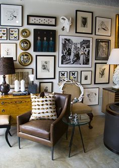 Elle decor; love the salon-style hanging of the art.