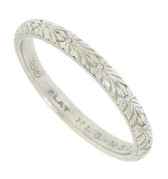 This Romantic Antique Platinum Wedding Band Is Adorned With Intricately Engraved Flowers And Leaves Set A String Of Fine Faceted Diamonds