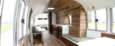 The Hof Arc team also redesigned a 1985 Airstream for client Delivering Happiness. Love the wood walls!