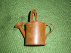 Small Rusted Watering Can for sale on Listia!  Starting bid at 100.