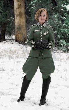 """CAVEAT: This supposed image of a """"colorized Nazi girl"""" (which has been relentlessly posted across the Internet, both in black-and-white and its likely original color) is an utterly inauthentic, 2015 cosplay re-enactment. Sadly, it's designed to appeal to gullible enthusiasts. It is not a genuine wartime image."""