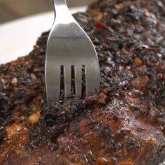 Fork going into slow cooker honey pork roast