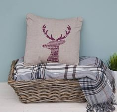This iconic yet quirky Scottish stag cushion would be a welcome addition to any comfy chair, sofa or settee. This luxury organic cotton stag cushion has been inspired by the classic image of a stag in silhouette. The pattern has been influenced by a combination of Fair Isle and Scandinavian design with a little bit of tribal pattern for good measure! This animal is a traditional symbol of the woodland in Scotland.