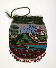 This bag, from the 1830s, has a beaded pattern in the form of a landscape, which runs around the whole of the bag. The top edge is crocheted in silk and the lower edge has a beaded fringe.