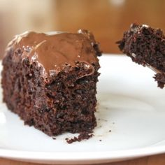 Healthy chocolate cake recipe with shredded zucchini, wheat flour, and apple sauce.