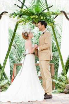 {a simple tropical arrangement with bamboo make the perfect ceremony setting}