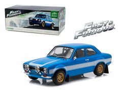 "Brian's 1974 Ford Escort RS2000 Mk1 Blue with White Stripes ""Fast & Furious 6"" Movie (2013 ) 1/18 Diecast Model Car by Greenlight - Brand new 1:18 scale diecast car model of Brian's 1974 Ford Escort RS2000 MK1 Blue with White Stripes ""Fast & Furious 6"" Movie (2013 ) by Greenlight. Limited Edition. Brand new box. Rubber tires. Made of diecast metal. Detailed interior, exterior. Dimensions approximately L-10.5, W-4.5, H-4 inches.-Weight: 4. Height: 8. Width: 15. Box Weight: 4. Box Width: 15…"