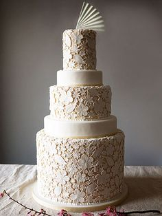 Cue the Tiers: 19 Dream Wedding Cakes for George and Amal | THAT'S AMORE | These two are super romantic: Who can forget George's sweet words about his soon-to-be bride and wedding? The couple could go for a traditionally amorous wedding cake, like this chic, lace-detailed design from Charm City Cakes in Baltimore.