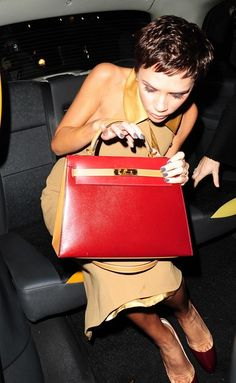 Victoria Beckham Leather Tote  Victoria Beckham carried a two-tone yellow and red leather tote while out at a restaurant in London.