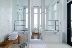 Encased glass bathing room includes 3 showers and a full-size soaking tub! #luxury #bathroom #interiordesign