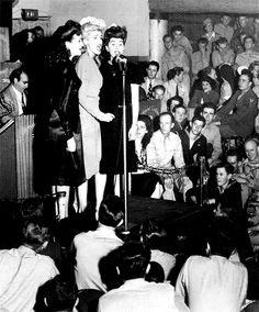 The Andrews Sisters perform at the Hollywood Canteen in the early 1940s.
