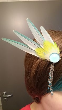 Cute feather hairpin made with feathers from my birds <3