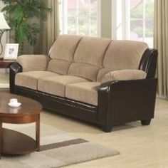 Gentle to the eye and to the touch, this unique two-toned sofa is the ultimate in comfort and style. Designed with thick boxed seat cushions, pillow-top arms, and channel-tufted back pillows, this couch offers the optimal comfort and support you need for long-term lounging and socializing.