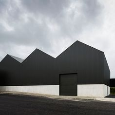 Ademia office and warehouse building by Joao Mendes Ribeiro. This recently renovated steel and concrete warehouse was used to exhibit Andy Warhol artwork Black Architecture, Factory Architecture, Industrial Architecture, Minimalist Architecture, Contemporary Architecture, Amazing Architecture, Architecture Details, Interior Architecture, Interior Design